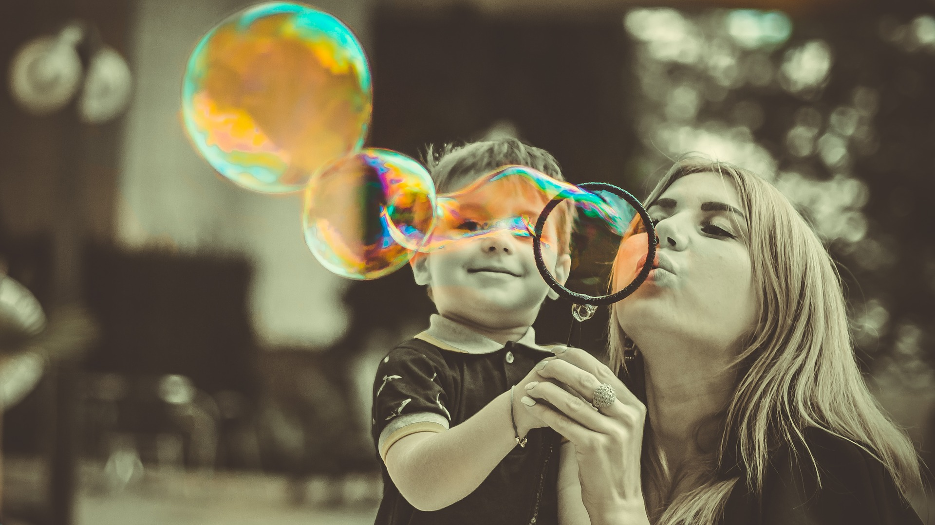 mother and son blowing bubbles together for Level One Theraplay and MIM training plus optional one-day Group training