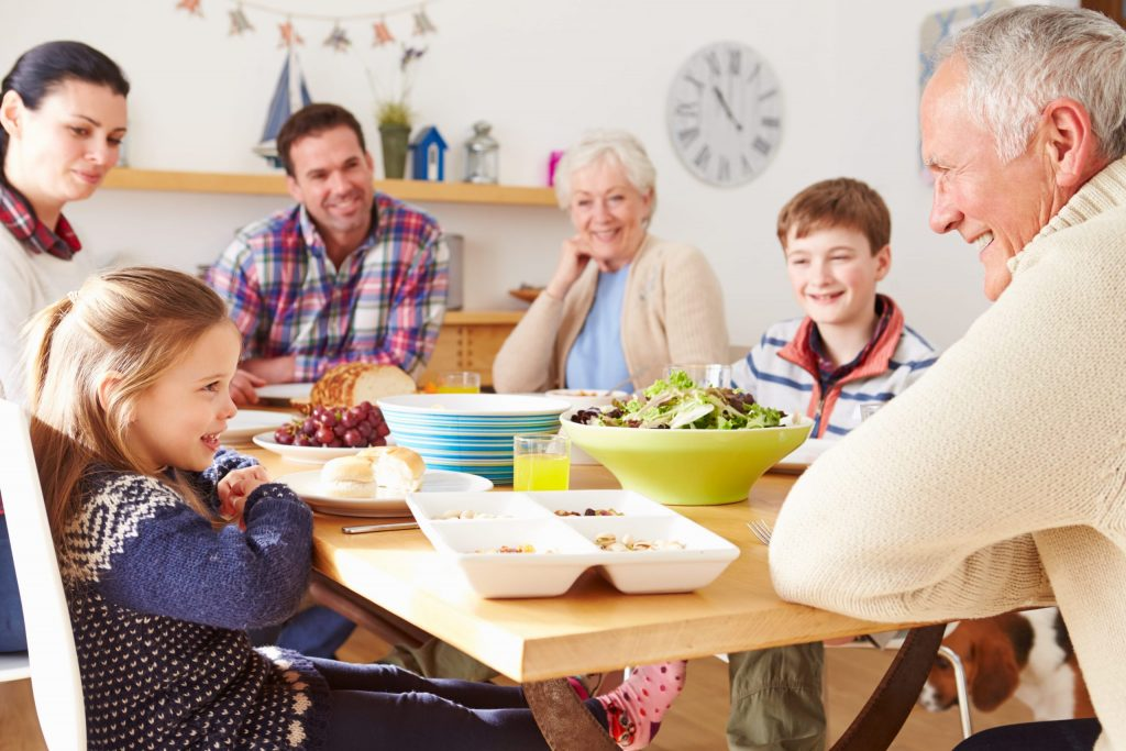 extended family at table - children, parents and grandparents