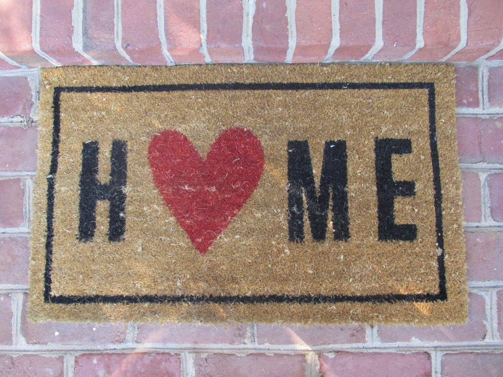 welcome doormat with the word HOME