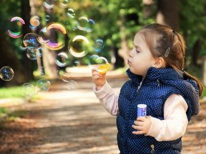 Helping children heal with theraplay by blowing bubbles