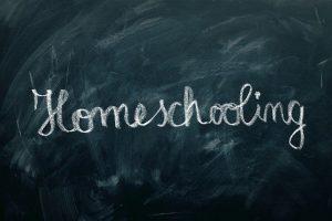 homwschooling written in white chalk on blackboard
